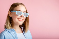 Smiling teenager girl portrait movie viewer in glasses isolated over pink color background with copy space. Young woman in cinema glasses for watching 3d movie in cinema
