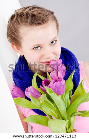 smiling teenager girl with pink tulips bouquet present gift easter mothersday valentine birthday