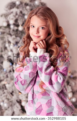 Smiling Teenager Girl 12 15 Year Old Wearing Trendy Sweater Over Christmas Tree Looking