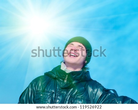 Smiling teenager on blue sky background #119526922
