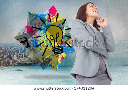 Smiling thoughtful businesswoman against city scene in a room