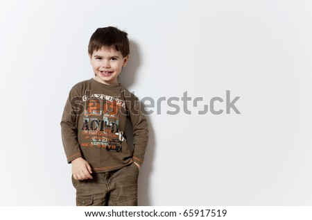stock photo : Smiling three year old boy studio portrait on background