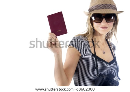 Smiling tourist woman with her camera, hat, and sunglasses showing her passport