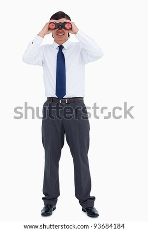 Smiling tradesman looking through spy glass against a white background