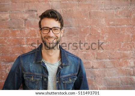 smiling trendy guy with blue...