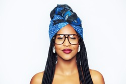 Smiling trendy young black woman in blue headscarf and glasses