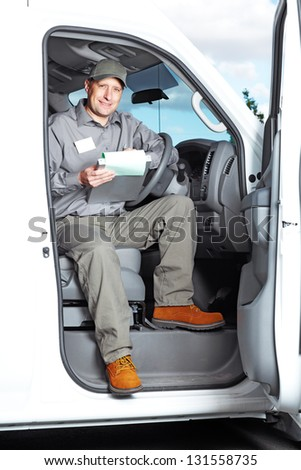 Smiling truck driver in the car Delivery cargo service