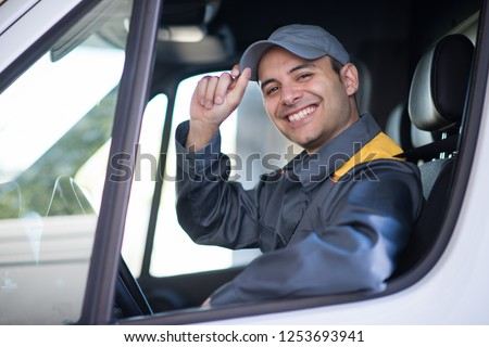 Smiling van driver portrait #1253693941