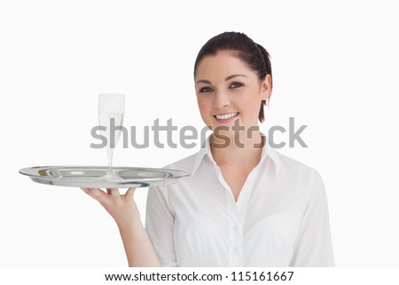 Smiling waitress holding silver tray with champagne glass