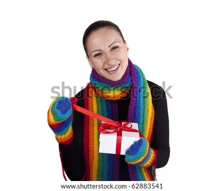 Smiling winter woman with gift