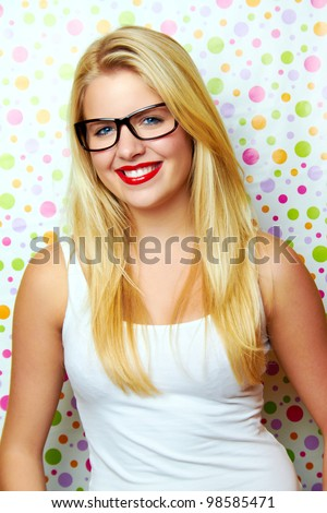 smiling woman against dot background