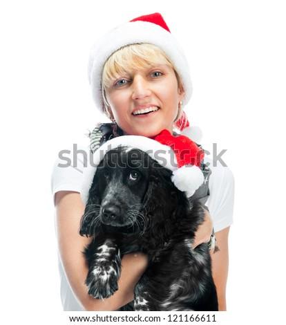 smiling woman and dog in santa hat at Christmas - stock photo