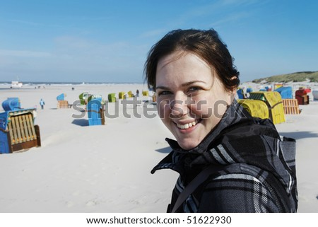 Smiling woman at the beach of the german island Juist