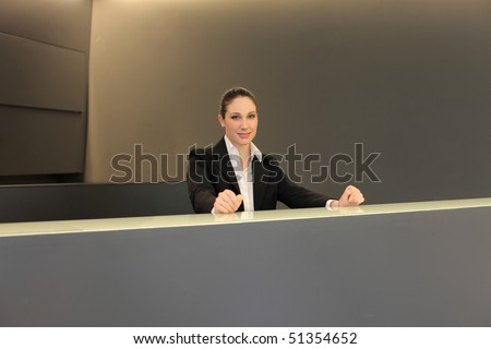 smiling woman at the reception desk