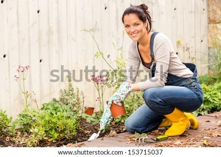 Smiling woman autumn gardening backyard housework hobby