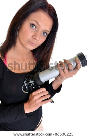 Smiling woman builder with caulking gun isolated on white background