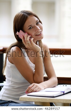 smiling woman  calling by phone - stock photo