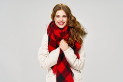 Smiling woman cosmetics checkered scarf lifestyle cool white jacket gray background