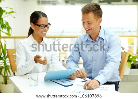 Smiling woman demonstrating the advantages of modern technology before hard copies