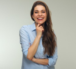Smiling woman dressed blue shirt isolated studio portrait.