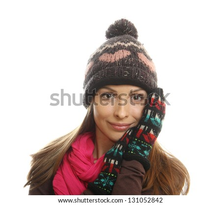 Smiling woman dressed in winter clothes, isolated on white