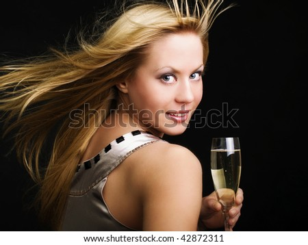 smiling woman drinking champange and celebrating