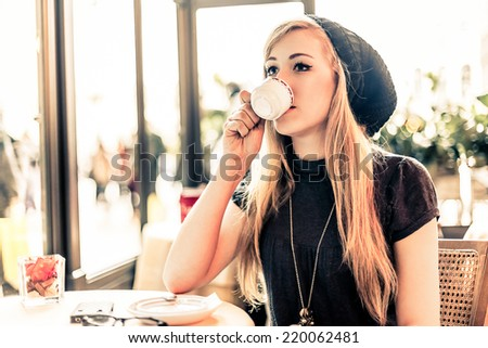 Photo of Smiling woman during coffee break