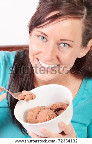 Smiling woman eating ice cream
