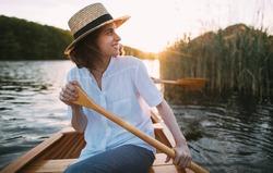 Smiling woman enjoying a canoe ride