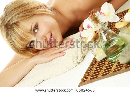 Smiling woman getting spa treatment isolated