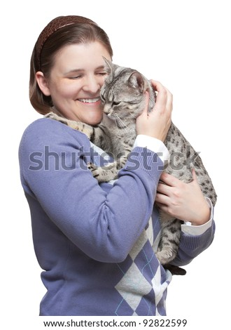 stock photo : Smiling woman holding a happy Egyptian Mau cat