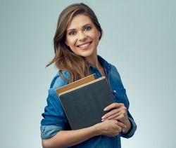 Smiling woman holding books. isolated portrait of school teacher.
