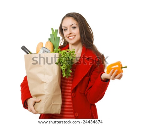 smiling woman holding grocery bag; healthy food