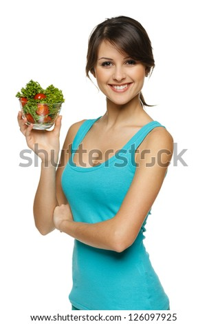 Smiling woman holding healthy salad meal over white