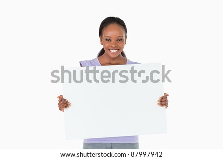 Smiling woman holding placeholder in her hands on white background