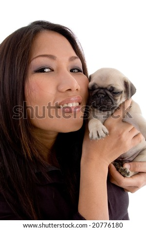 smiling woman holding puppy on an isolated  white background