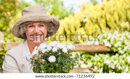 Smiling woman in her garden #71236492