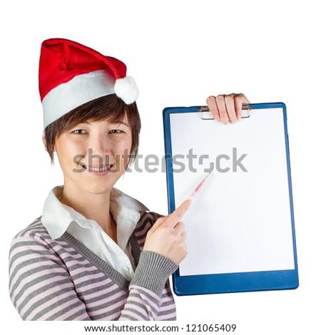 Smiling woman in Santa hat showing on whiteboard by pen