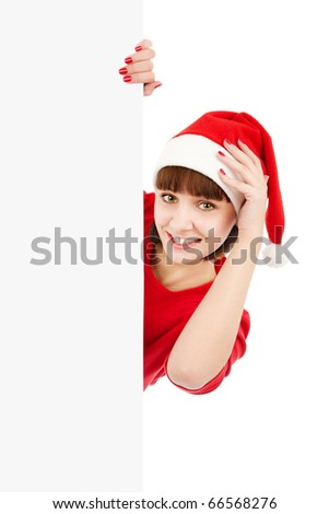 Smiling woman in Santa red hat holding blank sign billboard, isolated on white