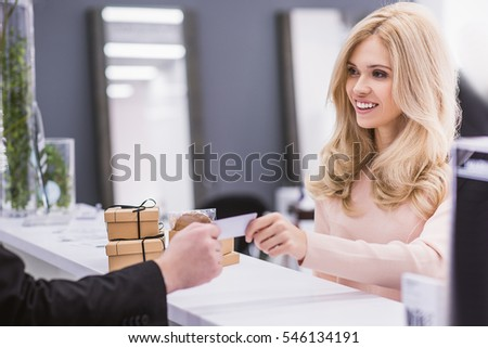 smiling woman is looking at...