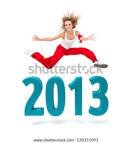 Smiling woman jumping over a 2013 New Year sign against isolated white background