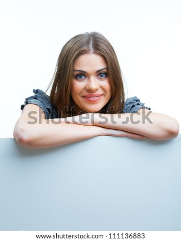 Smiling woman leaning on big blank board. Close up female face portrait with arms on blank card.