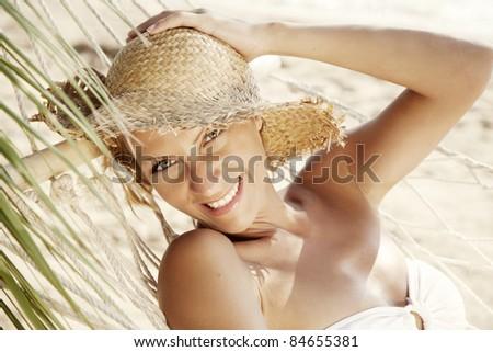 smiling woman lying in a hammock