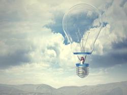 smiling woman on bulb balloon