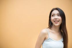 Smiling woman on orange background