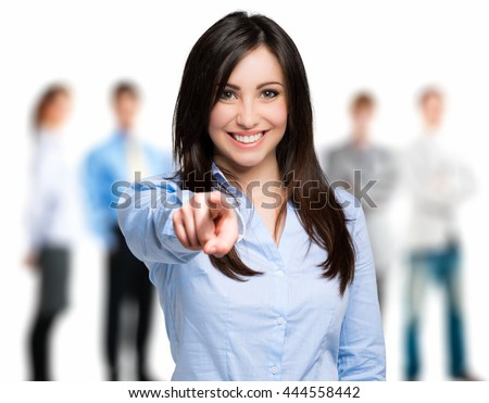 Photo of  Smiling woman pointing her finger to you