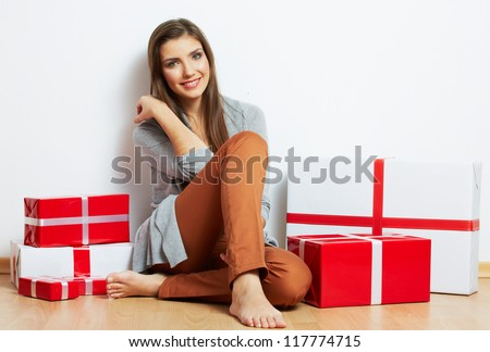 Smiling Woman portrait in christmas style with red, white box gift , isolated on white background.