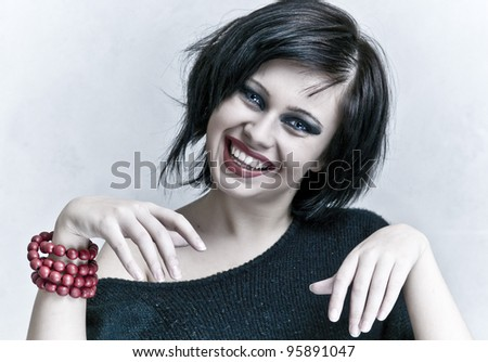 smiling woman portrait with white teeth and red lipstick