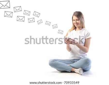Smiling woman sending sms from a mobile phone