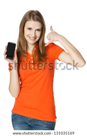 Smiling woman showing mobile phone and making call me gesture, over white background
